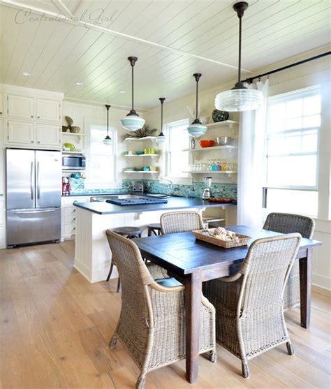 schoolhouse pendants grace kitchen of idyllic hawaiian