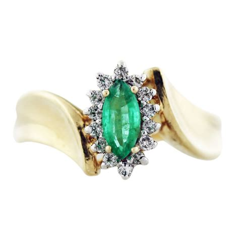 yellow gold marquise cut emerald and ring boca raton