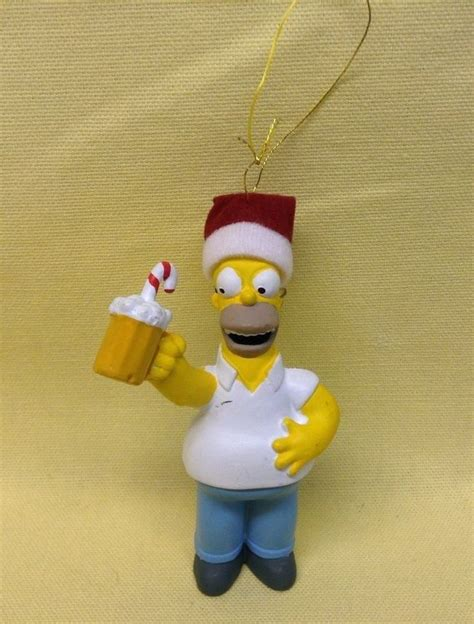 homer simpson holding a beer candy cane christmas tree