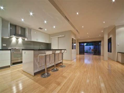 Recessed Baseboards classic island kitchen design using floorboards kitchen