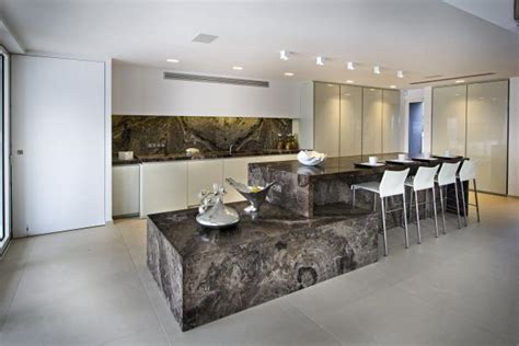modern kitchen with large multi level brown stone island