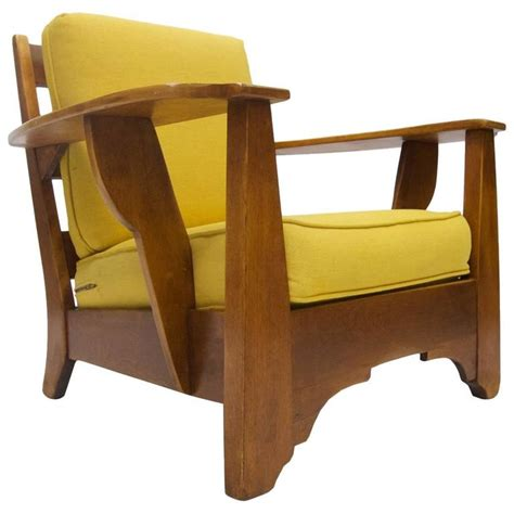 cushman wide paddle arm lounge chair in rock maple by