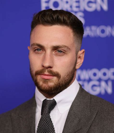 aaron taylor johnson looks like aaron taylor johnson looks beefy at the hollywood foreign