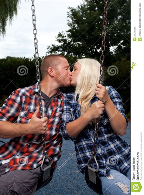 couple swinging video happy couple on swing set royalty free stock images