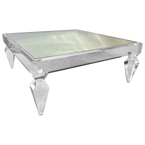 avenire lucite and mirror coffee table by craig den