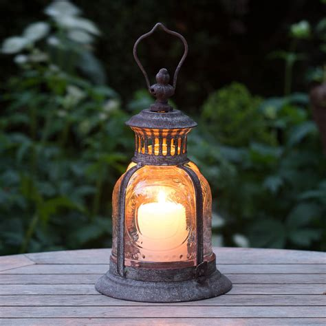 fleur de lys garden candle lantern by the flower studio