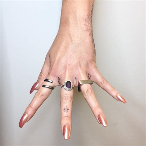 finger tattoo reviews tiny ornamental tattoos that will inspire you to adorn