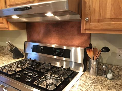 this rustic brown copper backsplash was made with our 10