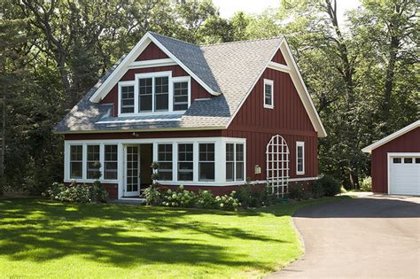 cute house with dormers wood front exterior of the little red sided cottage from the