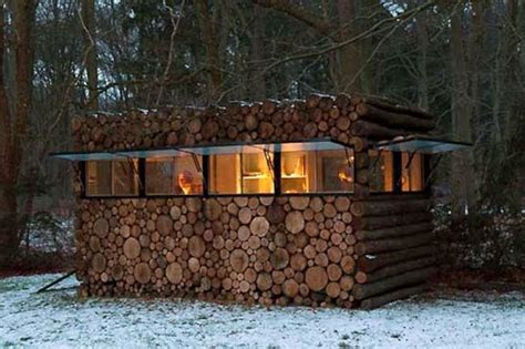 cool log cabins cool log cabin disguised as wooden stack