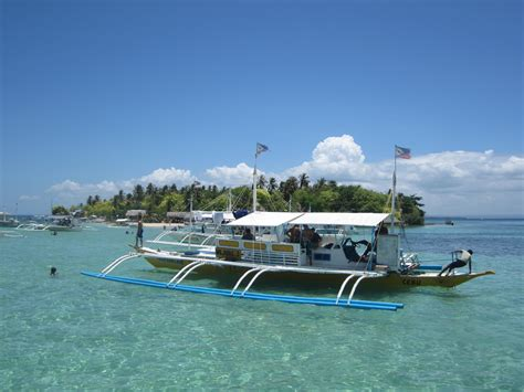 service island pandanon island and nalusuan island hopping tour cebu travel agency
