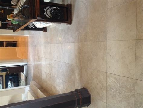 what paint color goes best with this travertine flooring open plan