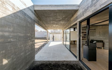 exposed concrete walls house by tectum features raw concrete walls and black metal