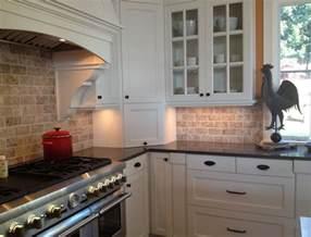 tile backsplash white cabinets black countertops
