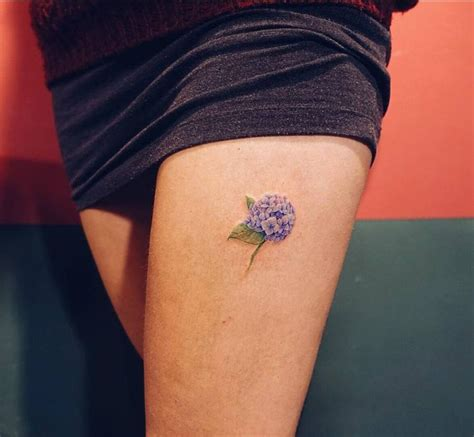 small upper thigh tattoos small hydrangea on the left thigh artist