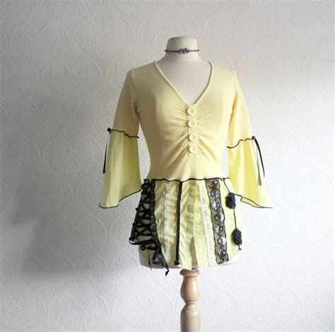 upcycled clothes ideas upcycled clothing black sweater s yellow top