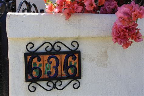 mex crafts imports ceramic house numbers in the front fence mexican home