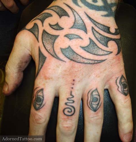 maori style tribal hand tattoo adorned tattoo