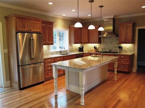 kitchen with oak cabinets stainless appliances gray stone tile backsplash white woodwork and