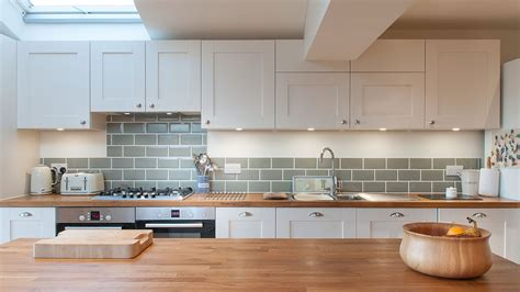 white shaker kitchen with wooden worktops burwash east