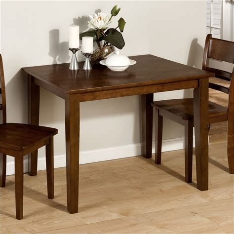 the small rectangular dining table that is for