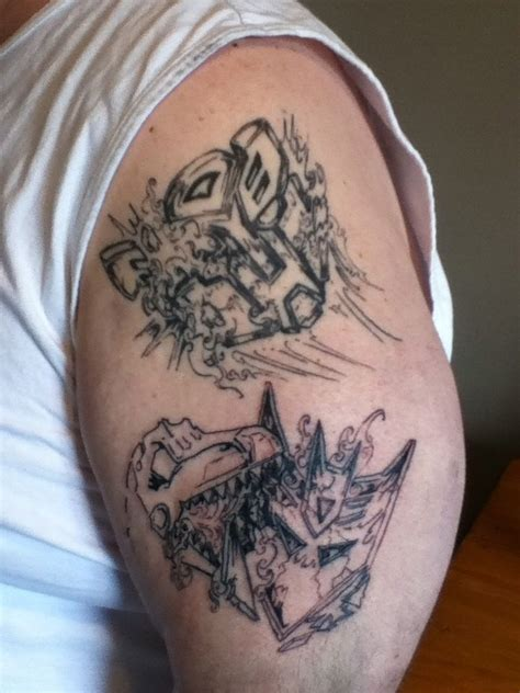 autobot tattoo transformers autobot and decepticon logo featuring