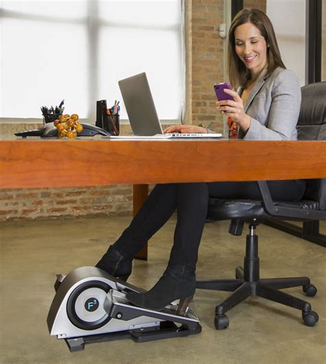 under desk foot exerciser cubii elliptical trainer brings fitness to the workplace