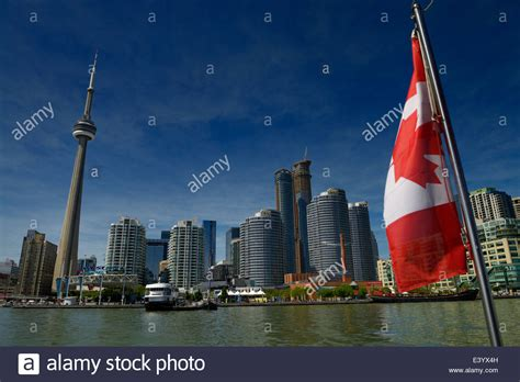 canadian boat flags canadian flag on a boat with toronto skyline cn tower and