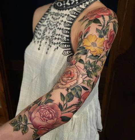 flowery sleeve pinterest tattoo