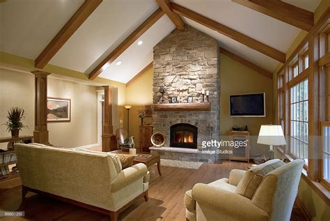 vaulted living room vaulted ceiling in living room with fireplace stock photo
