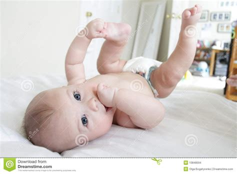 Baby Rolled by Baby Boy Rolling On Bed Stock Images Image
