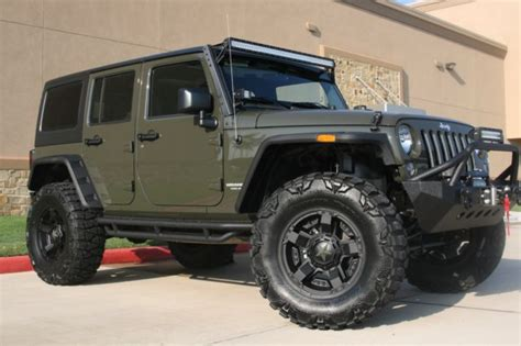 dark green jeep lifted 2015 jeep wrangler unlimited custom 4x4 tank green lifted