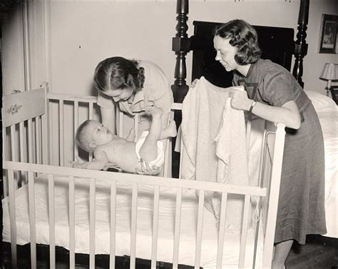putting baby in crib putting baby in crib
