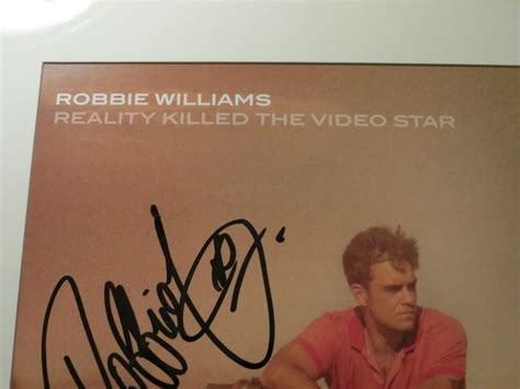 reveal robbie williams books robbie williams signed lithograph reality killed the