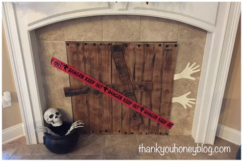 diy fireplace cover up diy spooky halloween fireplace cover