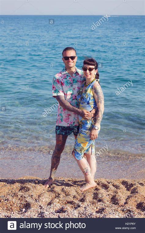 tattoo couple on beach tattooed couple on the beach stock photo royalty free