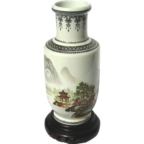 vintage signed porcelain vase on wooden stand from