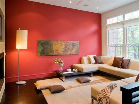 red walls in living room modern asian living room with beige sectional and red wall