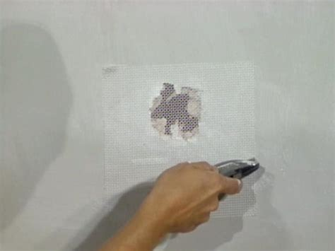 how to repair a hole in a fiberglass bathtub how to patch drywall with fiberglass mesh how tos diy