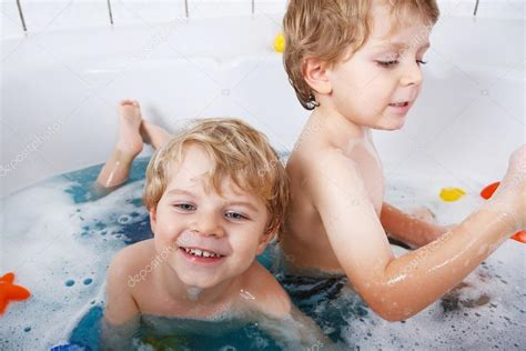 kids have sex in bathroom two little twins boys having fun with water by taking bath