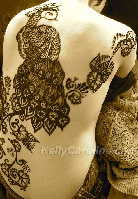 henna tattoo in back peacock henna caroline