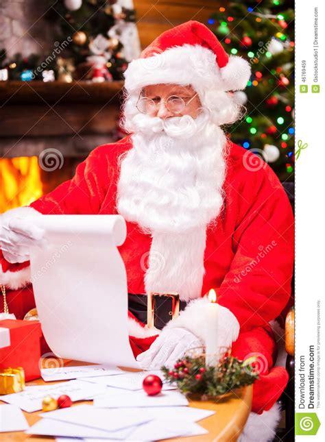 checking his christmas list stock image image 46769459