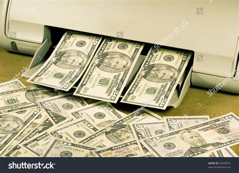 Who Makes Paper Money - counterfeit money on a home ink jet printer stock