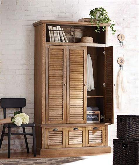 entry armoire armoire for coats and linens by the front door since we