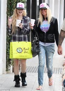 If I See Avril Finger The Paparazzi One More Time by Avril Lavigne And Friend Wear Matching Caps As They
