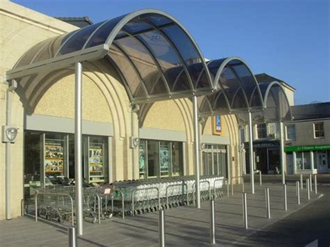 supermarket plymouth ef46 curved grey polycarbonate entrance feature