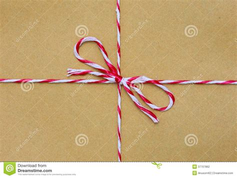 String On Paper - string in a bow brown paper stock photography