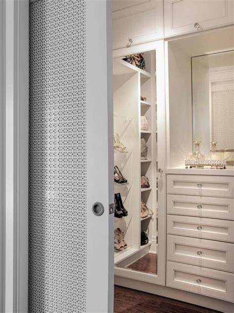 Shoe Closet With Doors Walk In Closet With Paneled Bi Fold Wardrobe Closet Doors Transitional Gorgeous Walk In Master Closet With Pocket Slide Doors With Fretwork Detail The Closet Features