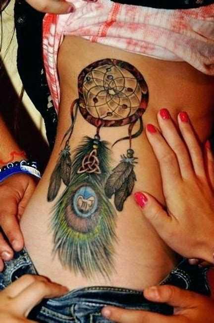 dreamcatcher tattoo with peacock feathers dreamcatcher tattoo my body language pinterest
