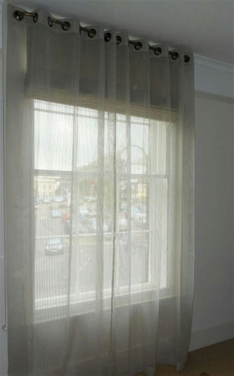sheer curtains for bay window sheer curtains over blinds can let light in without being